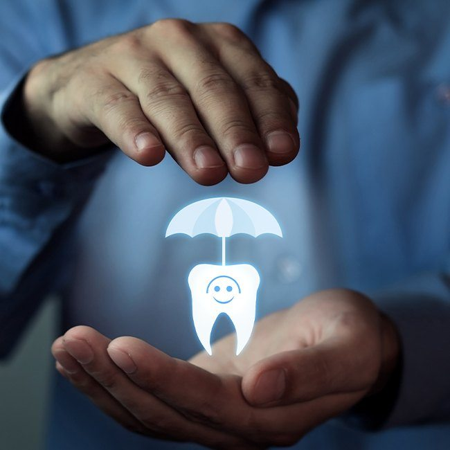 Animated tooth under an umbrella