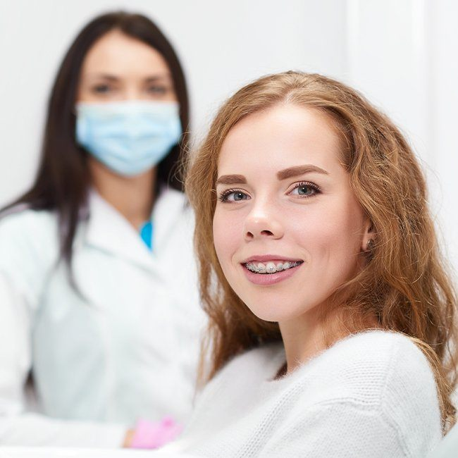 Woman with fastbraces smiling in dental chair